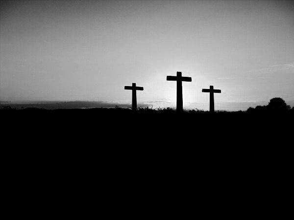 silhouette-of-crosses-on-hill-at-sunset-bw