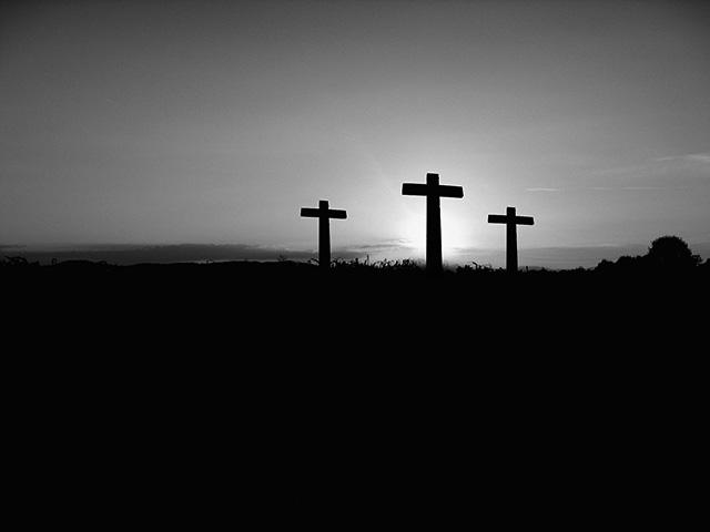 cross-on-hill-at-sunset-bw